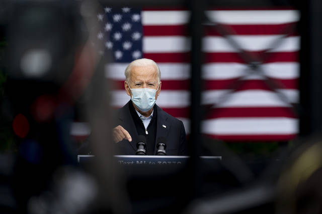 Democratic presidential candidate former Vice President Joe Biden speaks at United Food & Commercial Workers Union Local 951, Friday, Oct. 2, 2020, in Grand Rapids, Mich. (AP Photo/Andrew Harnik)