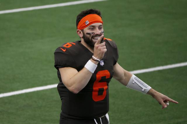 Cleveland Browns quarterback Baker Mayfield (6) celebrates on the field after their 49-38 win against the Dallas Cowboys in an NFL football game in Arlington, Texas, Sunday, Oct. 4, 2020. (AP Photo/Michael Ainsworth)