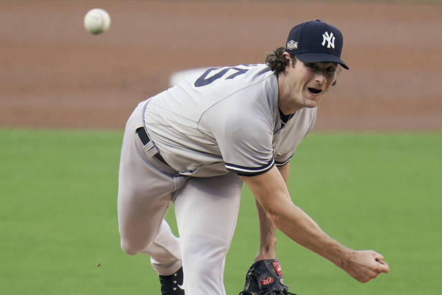 New York Yankees pitcher Gerrit Cole delivers against the Tampa Bay Rays during the first inning in Game one of a baseball American League Division Series Monday, Oct. 5, 2020, in San Diego. (AP Photo/Jae C. Hong)
