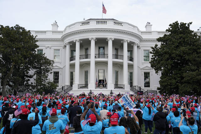 President Donald Trump speaks from the Blue Room Balcony of the White House to a crowd of supporters, Saturday, Oct. 10, 2020, in Washington. (AP Photo/Alex Brandon)