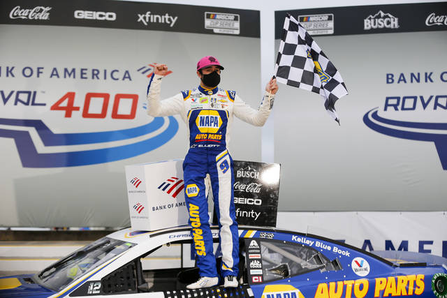 Chase Elliott celebrates in victory lane after winning a NASCAR Cup Series auto race at Charlotte Motor Speedway in Concord, N.C., Sunday, Oct. 11, 2020. (AP Photo/Nell Redmond)