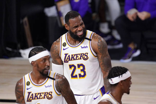Los Angeles Lakers' LeBron James (23) reacts during the first half in Game 6 of basketball's NBA Finals against the Miami Heat Sunday, Oct. 11, 2020, in Lake Buena Vista, Fla. (AP Photo/Mark J. Terrill)
