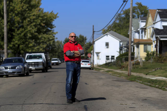 Gary Zaremba stands for a portrait outside of a house he oversees, Wednesday, Oct. 7, 2020, in Dayton, Ohio. Seven months after the pandemic began, landlords face an even more uncertain future. Zaremba, who owns and and manages 350 apartment units spread out over 100 buildings in Dayton, Ohio, said he has been working with struggling tenants and directs them to social service agencies for additional help. (AP Photo/Aaron Doster)
