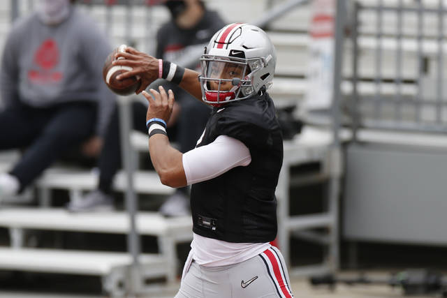 FILE - In this Oct. 3, 2020, file photo, Ohio State quarterback Justin Fields throws a pass during their NCAA college football practice in Columbus, Ohio. Fields returns for a second season as Ohio State starter. Coaches and teammates say Fields is in better shape because of diet and workout regimen, and is a more confident and vocal leader. (AP Photo/Jay LaPrete, File)