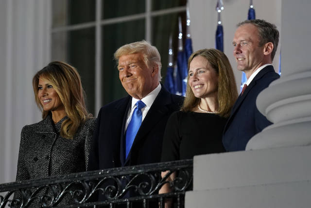 From left, first lady Melania Trump, President Donald Trump, Amy Coney Barrett and Jesse Barrett, stand on the Blue Room Balcony after Supreme Court Justice Clarence Thomas administered the Constitutional Oath on the South Lawn of the White House in Washington, Monday, Oct. 26, 2020. (AP Photo/Patrick Semansky)