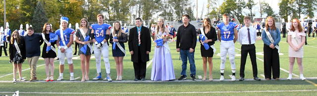 Veda Wenzler was crowned queen and Colton Doyle was crowned king Friday at the annual Clinton-Massie High School homecoming at Frank Irelan Field. In the photo from left to right, Brei Wulf, Will Marler, Courtney Fisher, 2020 King Colton Doyle, Heather Muselin, Joe Baughman, Leah Burton, Christian Burns, 2020 Queen Veda Wenzler, Clay Carroll, McKenzie Avery, Daniel Brewer, Richie Federle, Lacie Sandlin, and Emily Kay.
