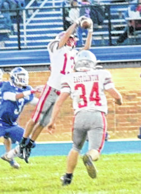 East Clinton's Landon Runyon (13) has had interceptions in each of the last two games.