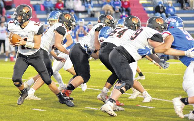 The Wilmington High School offensive line blocks for quarterback Peyton Hibbard during last Friday's game against Clinton-Massie.