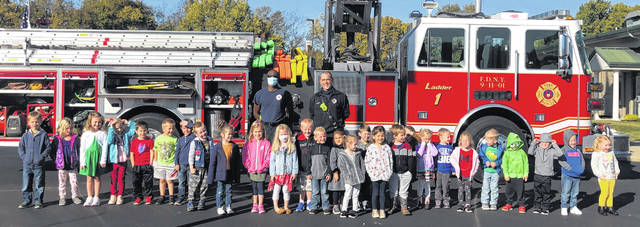 In observance of Fire Prevention Month, the Wilmington Fire Department came to visit the preschool classes at Bright Beginnings Tuesday School at Bible Baptist Church Wilmington. Pictured with the preschoolers are Firefighter Tim Doyle and Firefighter Shingai Calhoun.