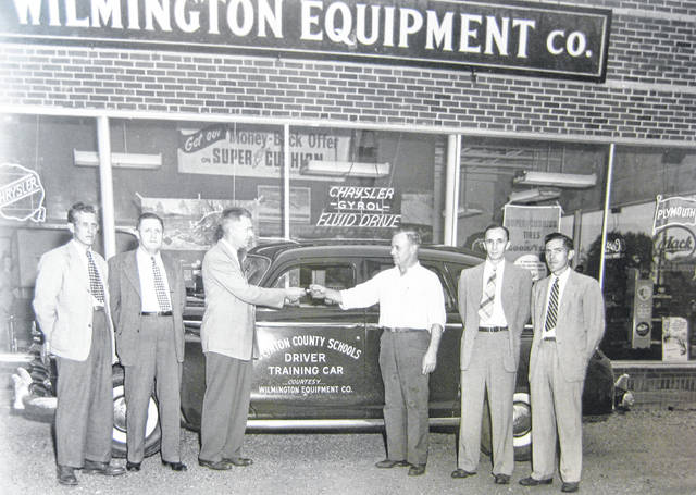"""In this photo, """"Clinton County Schools get a student driving car from Wilmington Equipment Co."""" Can you tell us more? Share it at info@wnewsj.com. The photo, which was taken by Robert McNemar, is courtesy of the Clinton County Historical Society. Like this image? Reproduction copies of this photo are available by calling the History Center. For more info, visit www.clintoncountyhistory.org; follow them on Facebook @ClintonCountyHistory; or call 937-382-4684."""