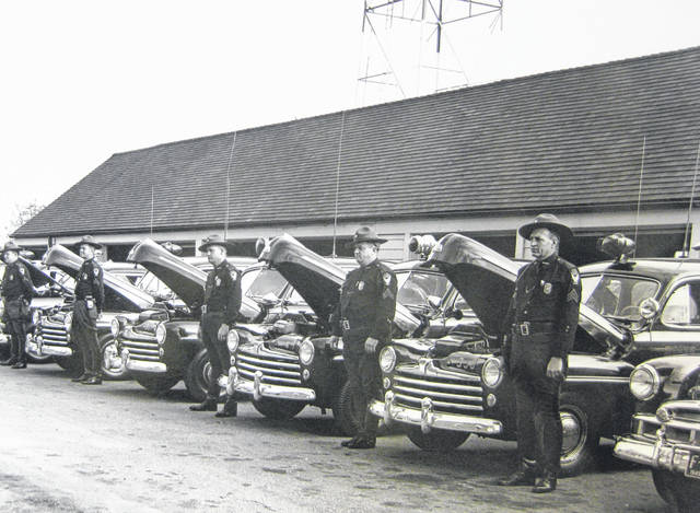 """This is """"Ohio State Highway Patrol inspection on October 25, 1949."""" Can you tell us more? Share it at info@wnewsj.com. The photo, which was taken by Robert McNemar, is courtesy of the Clinton County Historical Society. Like this image? Reproduction copies of this photo are available by calling the History Center. For more info, visit www.clintoncountyhistory.org; follow them on Facebook @ClintonCountyHistory; or call 937-382-4684."""