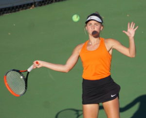 Burns does it, 1st girls tennis player to state