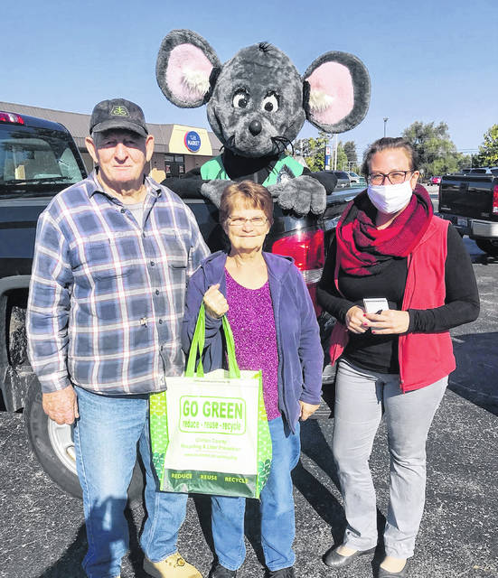 The annual Get Caught Recycling Campaign is underway, and Buster the Mouse has already caught his first recycling culprits. Pictured are Buster and SWMD Outreach Specialist Erin Hartsock presenting Jim and Ruth Everhart with a prize pack consisting of various recycled-content items. The Everharts are avid recyclers and said they have been dropping off their recyclables at Uhl's Market in Sabina for years. Be on the lookout for Buster the Mouse as you could be the next person caught green-handed. For more information on local recycling opportunities, visit www.co.clinton.oh.us/recycling or check out Clinton County Recycling and Litter Prevention on Facebook.