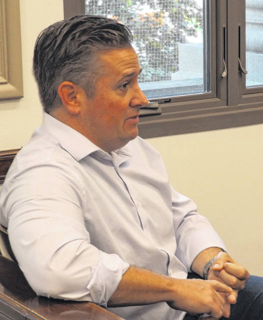 Clinton County Prosecuting Attorney Andrew T. McCoy speaks with commissioners Wednesday.