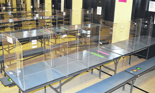 All lunchroom tables in Wilmington schools have see-through barriers as an added protection for students while they eat lunch.