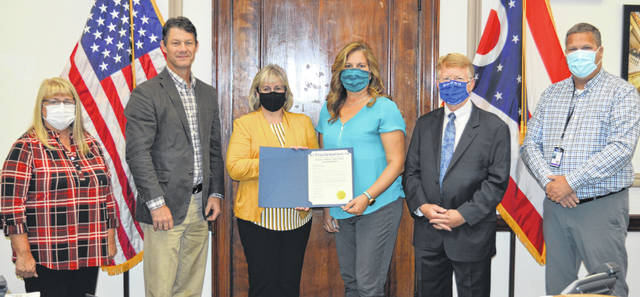 The Clinton County commissioners have proclaimed October as National Disability Employment Awareness Month. The proclamation calls upon people to advance the important message that people with disabilities are equal to the task throughout the year. From left are Clinton County Commissioners Brenda Woods and Kerry Steed, Southern State's College to Career Experience Coordinator Sonja Wilkin, Clinton County Board of Developmental Disabilities Employment First Coordinator Shanon Bene, Southern State President Dr. Kevin Boys, and Clinton County Commissioner Mike McCarty.