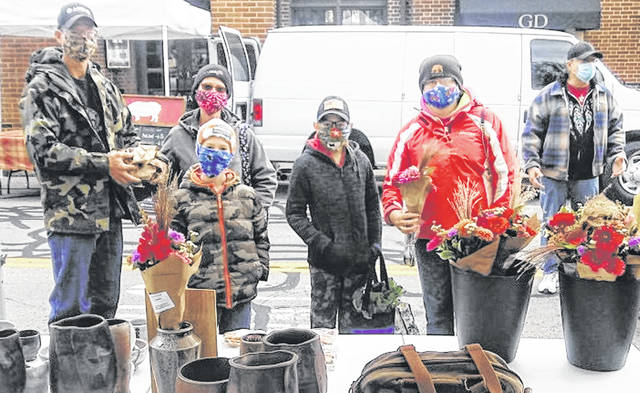 Attendees including family members of all ages masked up and shopped at the Market on Saturday.