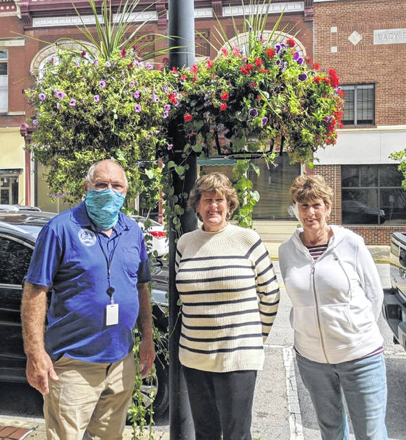 The Commercial Beautification Award was given to the Downtown Wilmington Community Improvement Corporation for their hanging baskets. From left are Wilmington Mayor John Stanforth and Garden Club members Kathy Kral and Carol Davidson.