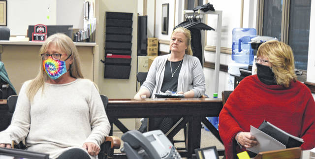 In the foreground from left are Clinton County Homeless Shelter Case Manager Darlene Pitzer and Clinton County Homeless Shelter Executive Director Denise Stryker; and listening in the background is Clinton County Administrator Mary Ann Haines Foland.