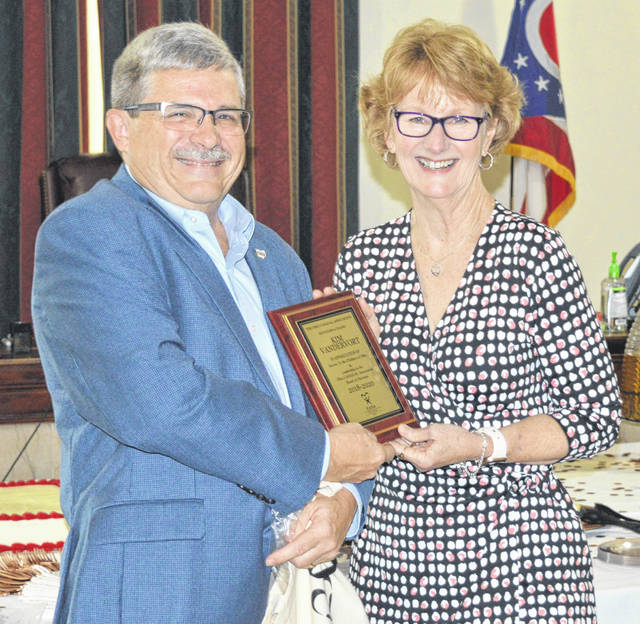 Clinton County CASA (Court-Appointed Special Advocates) Program Director Kim Vandervort, right, is retiring and was recognized by Doug Stephens, left, who is the Ohio CASA/GAL Association executive director. Vandervort worked 23 years with the Clinton County Juvenile, Probate, and Common Pleas Courts. In 1997, she began serving juvenile court as a Guardian ad Litem (GAL) for abused, neglected, and dependent children, as well as for unruly delinquent children, and custody cases involving unmarried parents. She served the probate court in guardianship cases, and served the common pleas court's domestic relations relation in private custody cases. Then in 2016, at the request of Judge Chad Carey, Vandervort started the Clinton County CASA program and has since trained 24 CASA volunteers. In addition to the state plaque, the Clinton County commissioners recognized Vandervort with a proclamation.