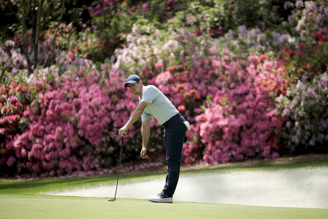 FILE - In this April 8, 2019, file photo, Rory McIlroy, of Northern Ireland, watches his putt on the 13th hole during a practice round for the Masters golf tournament in Augusta, Ga. Because of the coronavirus pandemic, the Masters is being held in November (Nov. 12-15) for the first time. (AP Photo/Charlie Riedel, File)