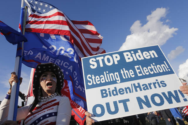 Supporters of President Donald Trump rally in Beverly Hills, Calif., Saturday, Nov. 7, 2020. Democrat Joe Biden defeated President Donald Trump to become the 46th president of the United States on Saturday, positioning himself to lead a nation gripped by the historic pandemic and a confluence of economic and social turmoil. (AP Photo/Ringo H.W. Chiu)
