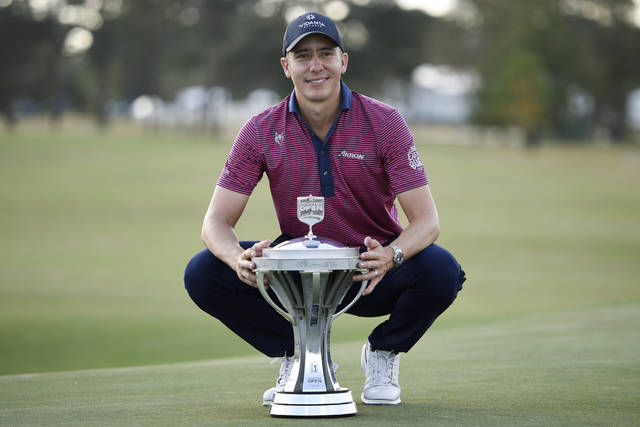 Carlos Ortiz poses with the champion's trophy after winning the Houston Open golf tournament, Sunday, Nov. 8, 2020, in Houston. (AP Photo/Eric Christian Smith)