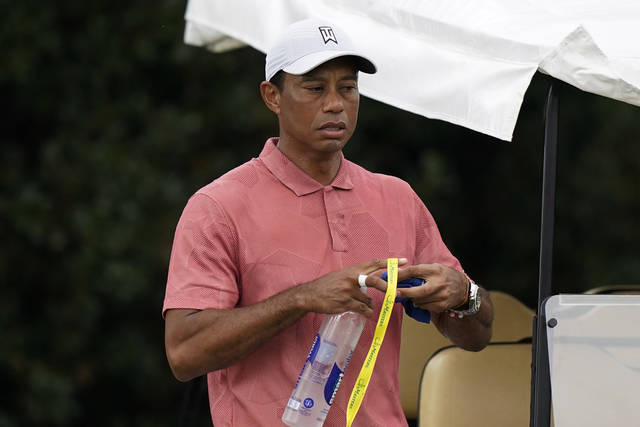 Tiger Woods leaves the driving range during a practice round for the Masters golf tournament Tuesday, Nov. 10, 2020, in Augusta, Ga. (AP Photo/David J. Phillip)
