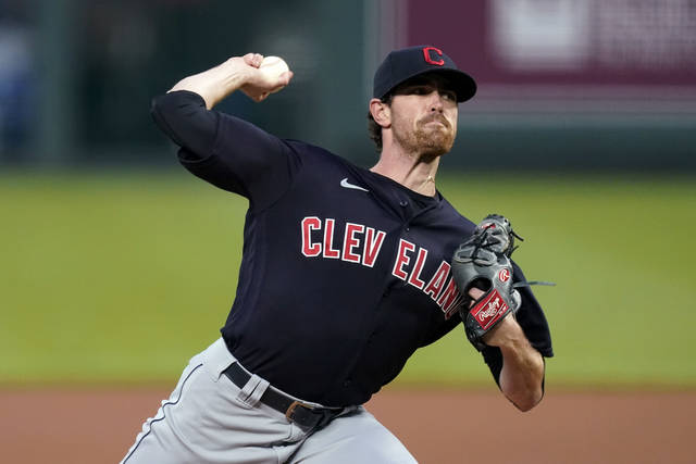 FILE - In this Aug. 31, 2020, file photo, Cleveland Indians starting pitcher Shane Bieber throws during the first inning of the team's baseball game against the Kansas City Royals in Kansas City, Mo. Bieber won the AL Cy Young Award on Wednesday night, Nov. 11, 2020. (AP Photo/Charlie Riedel, File)
