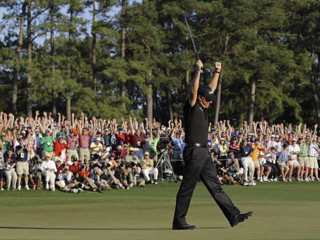 FILE - In this April 11, 2010, file photo, Phil Mickelson celebrates on the 18th green after winning the Masters golf tournament in Augusta, Ga. That was his third green jacket, and he has not added to the total the last 10 years. (AP Photo/David J. Phillip, File)