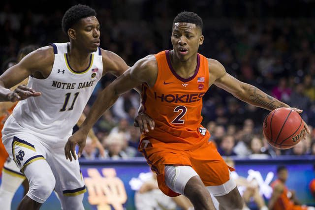 File-This March 7, 2020, file photo shows Virginia Tech's Landers Nolley II (2) and Notre Dame's Juwan Durham (11) during an NCAA college basketball game, in South Bend, Ind. Nolley, a 6-7 sophomore, received an NCAA waiver enabling him to play for Memphis this year. He averaged 15.8 points, 5.8 rebounds, and 2.4 assists as a freshman for Virginia Tech last season. (AP Photo/Robert Franklin, File)