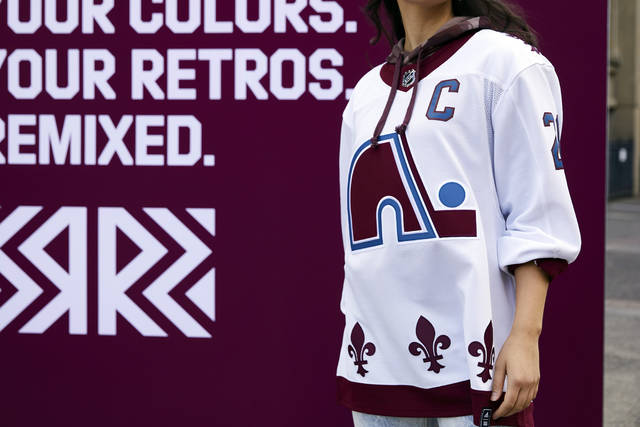 "This undated photo provided by Adidas shows the Colorado Avalanche's newest NHL hockey jersey featuring the logo and design of the Quebec Nordiques, which the team was known as until moving to Denver in 1995. The NHL and Adidas on Monday, Nov. 16, 2020, unveiled a ""Reverse Retro"" jersey for all 31 teams, a way to spark interest before the next season begins. (Courtesy of Adidas via AP)"