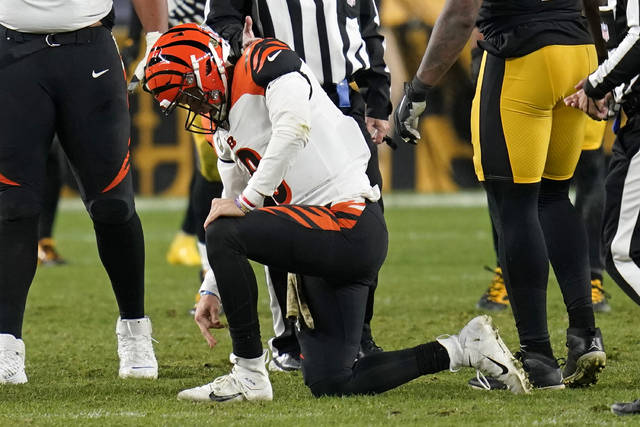 Cincinnati Bengals quarterback Joe Burrow (9) gets up slowly after being sacked by Pittsburgh Steelers outside linebacker T.J. Watt (90) during the second half of an NFL football game, Sunday, Nov. 15, 2020, in Pittsburgh. (AP Photo/Keith Srakocic)