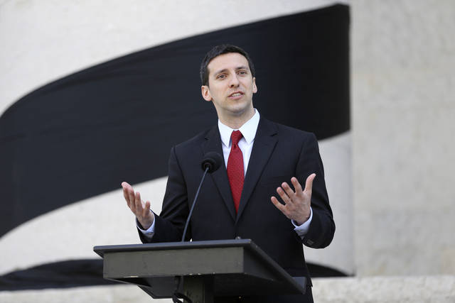 "FILE - In this May 14, 2015, file photo, Cincinnati Councilman P.G. Sittenfeld speaks outside of the Ohio Statehouse, in Columbus, Ohio. Sittenfeld, who has been planning to run for mayor, has been indicted on federal corruption charges, and faces six federal counts related to bribery and extortion. It states that Sittenfeld solicited $40,000 in payments to his political action committee to ""deliver the votes"" in the city council for a proposed downtown real estate development. (Courtney Hergesheimer/The Columbus Dispatch via AP, File)"