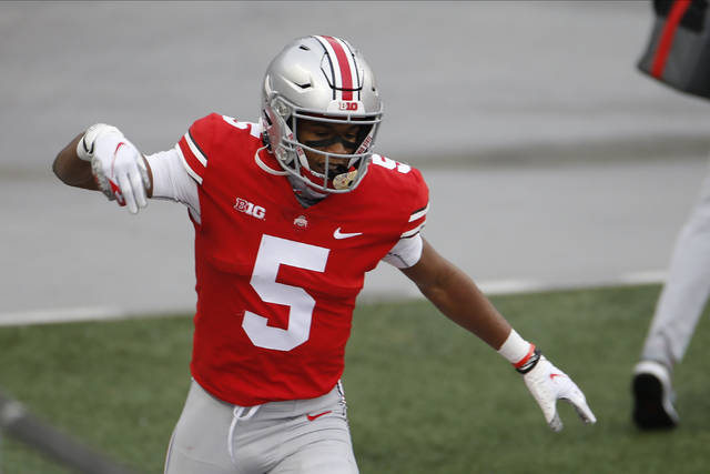 Ohio State receiver Garrett Wilson celebrates his touchdown against Indiana during the first half of an NCAA college football game Saturday, Nov. 21, 2020, in Columbus, Ohio. (AP Photo/Jay LaPrete)