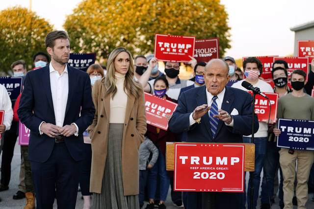 Rudy Giuliani, a lawyer for President Donald Trump, speaks during a news conference on legal challenges to vote counting in Pennsylvania, Wednesday, Nov. 4, 2020, in Philadelphia. At left are Eric Trump, son of President Trump, and his wife Lara Trump. (AP Photo/Matt Slocum)