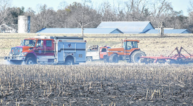 The Wilmington Fire Department extinguishes a field fire at a Gumley Road property on Wednesday afternoon.