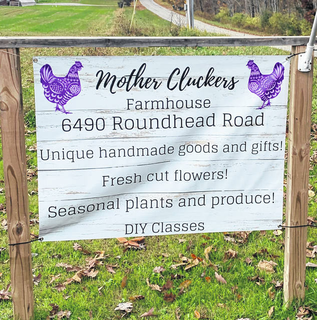 Mother Cluckers Farmhouse sign.