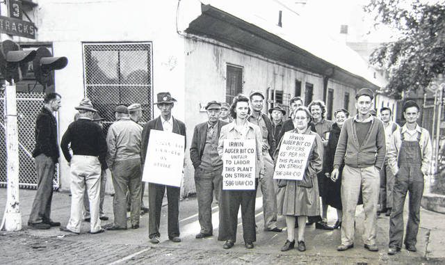Workers of Local 586 of the United Automobile Workers at the Irwin Auger Bit Co. in Wilmington went on strike Sept. 4, 1946. The minimum wage there was 55 cents and workers sought 84 cents. The strike finally ended on Oct. 28 when the sides agreed to resume negotiations. Can you tell us more? Share it at info@wnewsj.com. The photo, which was taken by Robert McNemar, is courtesy of the Clinton County Historical Society. Like this image? Reproduction copies of this photo are available by calling the History Center. For more info, visit www.clintoncountyhistory.org; follow them on Facebook @ClintonCountyHistory; or call 937-382-4684.