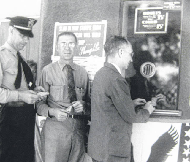 City of Wilmington officials purchase war stamps at the Lamax Theatre. Can you tell us more? Share it at info@wnewsj.com. The photo is courtesy of the Clinton County Historical Society. Like this image? Reproduction copies of this photo are available by calling the History Center. For more info, visit www.clintoncountyhistory.org; follow them on Facebook @ClintonCountyHistory; or call 937-382-4684.
