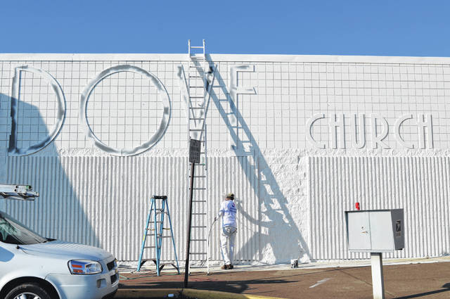 Exterior work continues at Dove Church Wilmington on Rombach Avenue. In the photo, a painter takes advantage of Saturday's nice weather. An illuminated sign will be installed on the building's front.