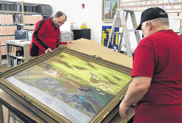 History Center staff and volunteers prepare the works of art for transport to Columbus.