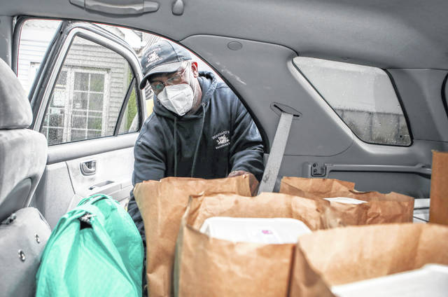 Marty Beaugard loads up a vehicle to deliver comfort meals to area senior citizens.
