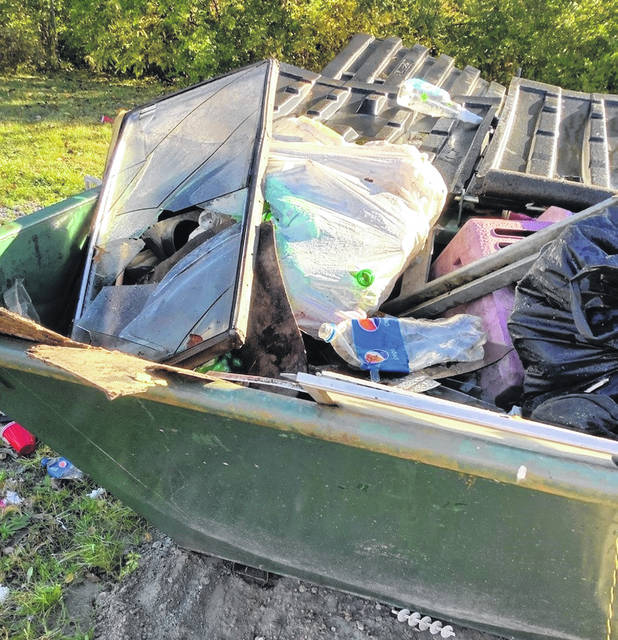 The Clinton County Solid Waste Management District provided these photos to show how <em>not</em> to drop off materials at recycling containers; these photos were taken in Midland.