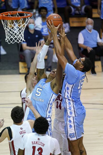 North Carolina forward Armando Bacot (5) and forward Garrison Brooks (15) leap for a rebound against UNLV in the second half of an NCAA college basketball game in the Maui Invitational tournament, Monday, Nov. 30, 2020, in Asheville, N.C. (AP Photo/Kathy Kmonicek)
