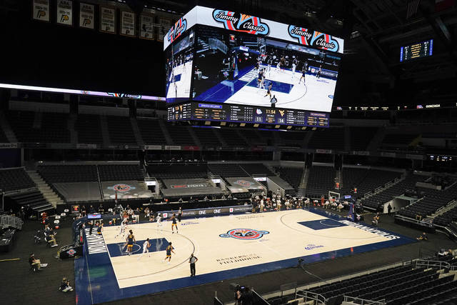 West Virginia and Gonzaga play during the first half of an NCAA college basketball game, Wednesday, Dec. 2, 2020, in Indianapolis. Gonzaga was scheduled to play Baylor but the game was cancelled due to COVID. (AP Photo/Darron Cummings)