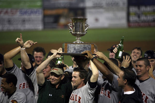 FILE - In this Sept. 11, 2007, file photo, members of the Frederick Keys celebrate after they defeated the Salem Avalanche in the deciding game of the Carolina League championship in Salem, Va. The Keys lost professional status, in a reorganization of minor league baseball. The team, which had been a Baltimore affiliate, will be part of the Draft League that was announced last month for prospects ahead of the amateur draft. (Stephanie Klein-Davis/The Roanoke Times via AP, File)