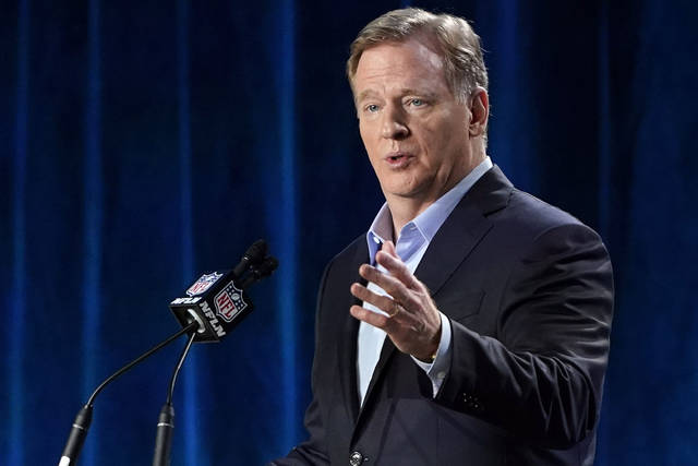 FILE - In this Jan. 29, 2020, file photo, NFL Commissioner Roger Goodell answers a question during a news conference for the NFL Super Bowl 54 football game in Miami. Goodell says the league remains committed to finishing the regular season as scheduled. Goodell also said on a conference call that while the NFL is considering a bubble format for the playoffs, it wouldn't necessarily resemble what the NHL and NBA used successfully in completing their seasons. (AP Photo/David J. Phillip, File)