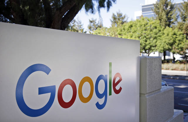 CORRECTS TO A GROUP OF 35 STATES AS WELL AS THE DISTRICT OF COLUMBIA AND TERRITORIES OF GUAM AND PUERTO RICO FILED, INSTEAD OF 38 STATES FILE - This Oct. 20, 2015, file photo, shows signage outside Google headquarters in Mountain View, Calif. A group of 35 states as well as the District of Columbia and the territories of Guam and Puerto Rico filed an anti-trust lawsuit against Google on Thursday, Dec. 17, 2020, alleging that the search giant has an illegal monopoly over the online search market that hurts consumers and advertisers. The lawsuit, announced by Colorado Attorney General Phil Weiser, was filed in federal court in Washington, D.C. by states represented by bipartisan attorneys general. (AP Photo/Marcio Jose Sanchez, File)