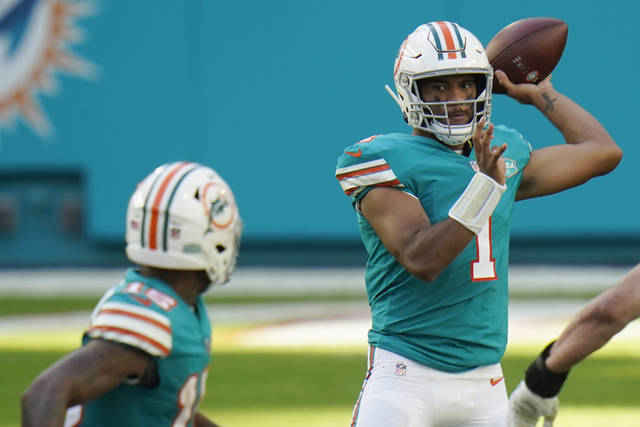 Miami Dolphins quarterback Tua Tagovailoa (1) attempts to throw a pass, during the second half of an NFL football game against the New England Patriots, Sunday, Dec. 20, 2020, in Miami Gardens, Fla. The Dolphins defeated the Patriots 22-12. (AP Photo/Chris O'Meara)